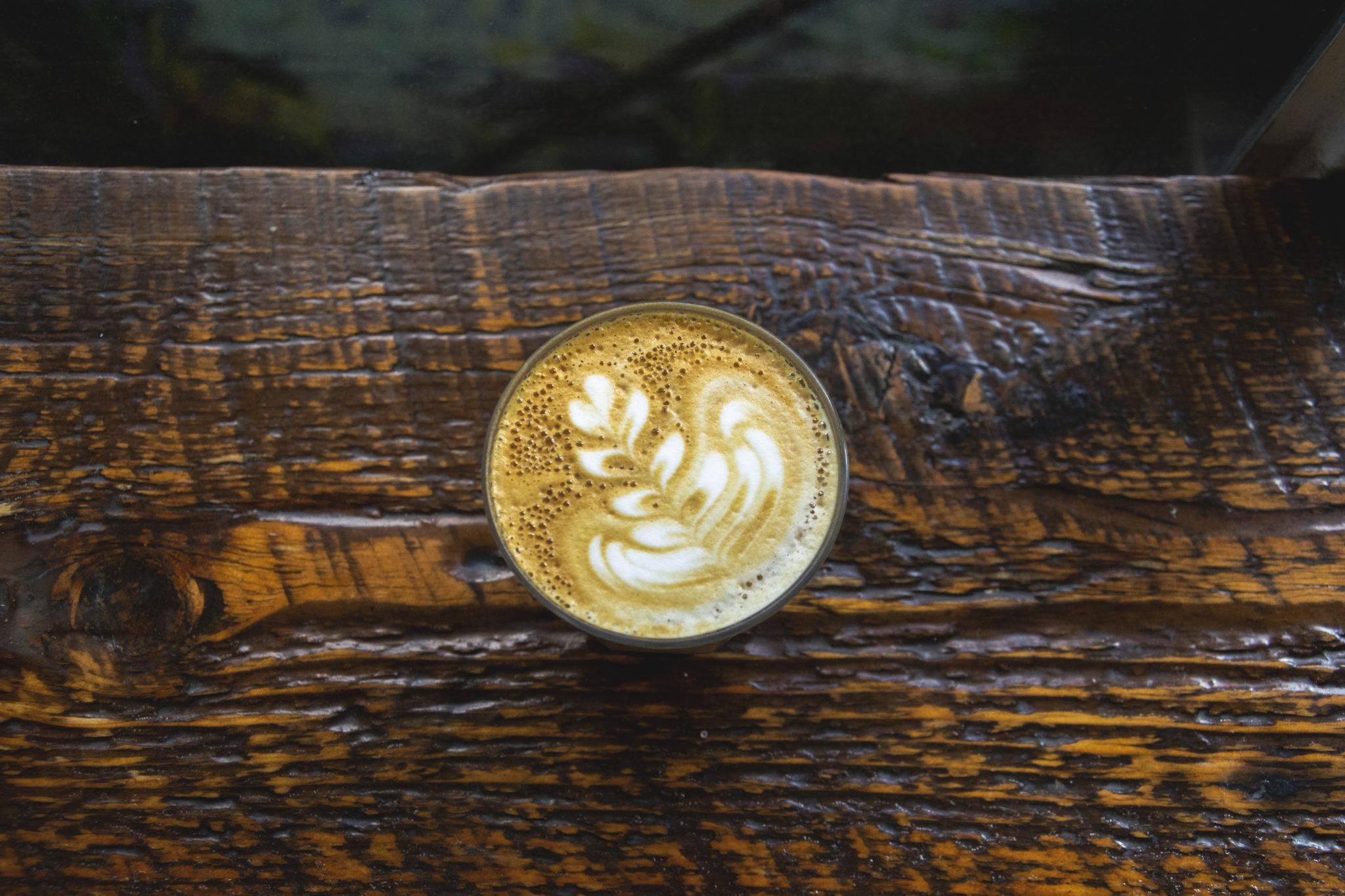 latte art on wooden shelf